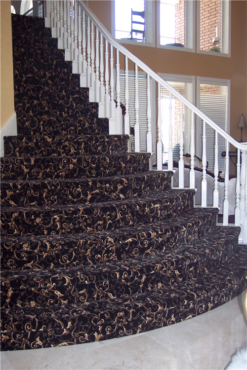 Woven Patterned Carpet on Stairs. They are curved and bow out like a wedding cake.