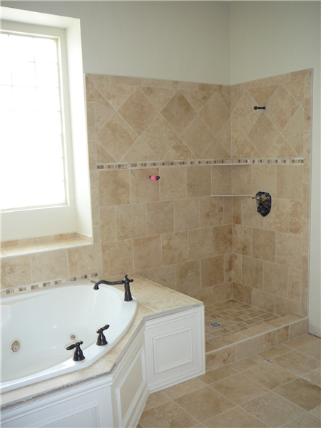 See the previous photo to see what this bathroom looked like before the tile was installed.